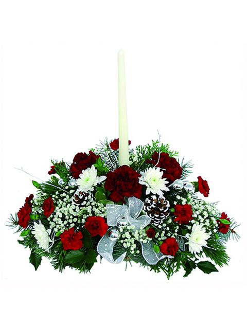 Centrotavola natalizio con fiori e candela a Roma