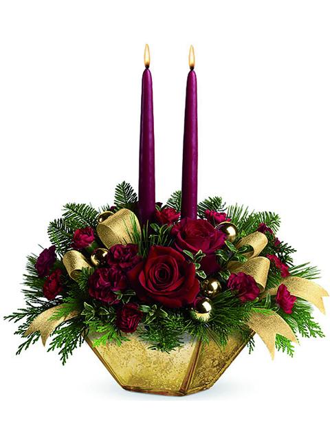 Ciotola con rose rosse e due candele a Roma