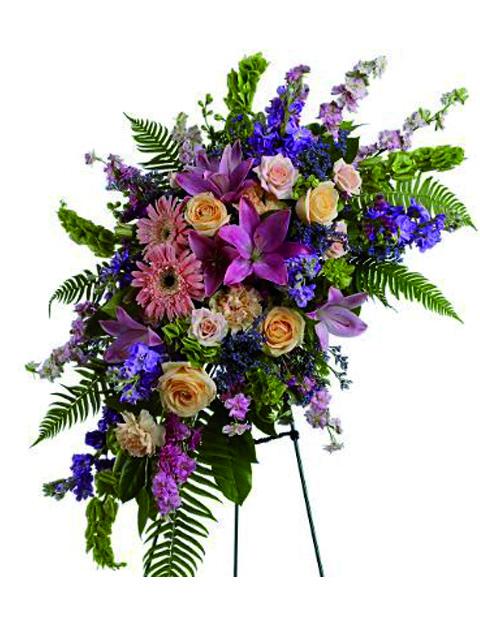 Cuscino funebre dai fiori di colore tenue a Roma